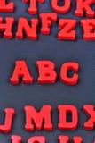 Abc-ord på svart bakgrund Royaltyfri Bild