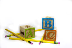 ABC and Pencils-background. Wooden ABC's and yellow pencils for back to school Royalty Free Stock Photos
