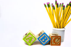 ABC and Pencils-background. Wooden ABC's and yellow pencils for back to school Royalty Free Stock Images