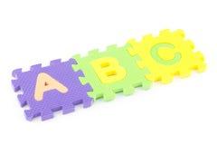 ABC pone letras a pedazos del rompecabezas Imagen de archivo libre de regalías