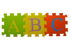 Abc puzzle blocks. Over white Stock Photography