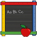 ABC Ruler Blackboard. Back to school blackboard with colored ruler frame.  ABC in chalk on writing lines, red apple. Copy space to add your own text Royalty Free Stock Photography