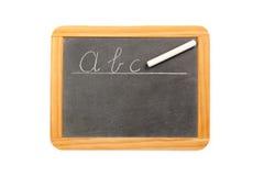 Abc som är skriftlig på den svart tavlan för tappning Royaltyfri Foto