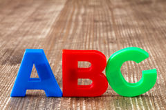 ABC spelling  of colorful plastic letters Stock Images