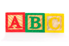 ABC wooden learning blocks in a row Royalty Free Stock Images