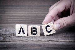 Abc. Wooden letters on the office desk, informative and communication background Stock Photos
