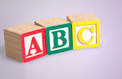 Abc word. On purple background stock images