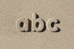 Abc written in sand letters. Royalty Free Stock Photo