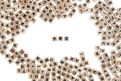 Abc written in small wooden cubes. ABC framed by small wooden cubes with letters isolated on white background Royalty Free Stock Photo