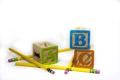 ABC y Lápiz-fondo Fotos de archivo libres de regalías