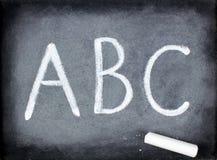 ABC y tiza - pizarra Fotografía de archivo libre de regalías