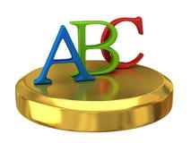 ABC-Zeichen auf Goldpodium Stockfotos