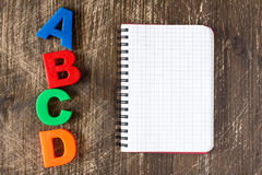 ABCD spelling  and blank notebook Stock Photography
