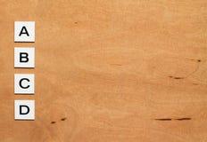 ABCD Test on the wood background. A, B, C, D like an answer option Stock Photos