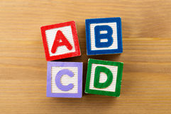 ABCD toy block. ABCD wooden toy block over the wooden background Stock Photos