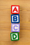 ABCD wooden toy block. Over the wooden background Royalty Free Stock Photography