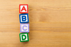 ABCD wooden toy block. Over the wooden background Stock Image