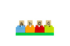 Abcd word on wood stamps and colorful toy blocks. Abcd word on wood stamps stack on colorful toy blocks, playing and learning language concepts Royalty Free Stock Photography