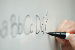 ABCs. Writing ABCs on a whiteboard Stock Photos