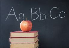 ABCs, apple, & chalkboard. Aa BbCc on chalkboard, apple and stack of books Royalty Free Stock Images