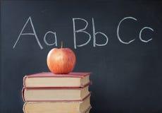 ABCs, manzana, y pizarra Imágenes de archivo libres de regalías