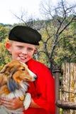 Abd del chico del campo su collie Foto de archivo