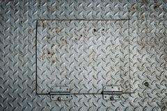 Abdeckung der Metallluke Stockbilder