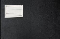Abdeckung eines dunklen alten Anmerkungsbuches. Stockbild