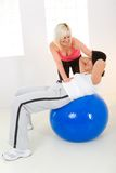 Abdomen exercise on fitness ball Royalty Free Stock Images