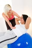 Abdomen exercise on fitness ball Stock Photography