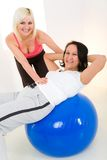 Abdomen exercise on fitness ball Stock Photo