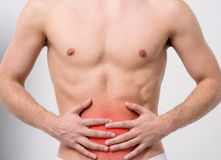Abdomen its too painful. Stock Photos