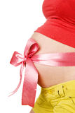 Abdomen a young pregnant woman tied with a Red rib Royalty Free Stock Image