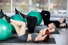 Abdominal crunch on balls Royalty Free Stock Photo