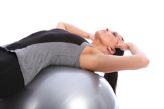 Abdominal crunches by fit woman on exercise ball Stock Image