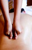 Abdominal massage. Closeup of a woman having a massage at her back Royalty Free Stock Images