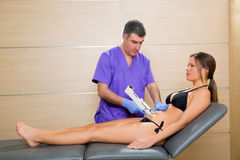 Abdominal mesotherapy gun therapy doctor to woman Royalty Free Stock Image