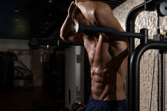 Abdominal Muscle Close-Up. Portrait Of A Physically Fit Man Posing In Modern Fitness Center Gym stock image
