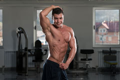 Abdominal Muscle Close-Up. Portrait Of A Physically Fit Man Showing His Well Trained Body In Gym stock images