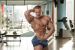 Abdominal Muscle Close-Up. Serious Man Standing In The Gym And Flexing Muscles stock image