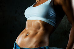 Abdominal muscles. Young sports woman abdominal muscles stock photography