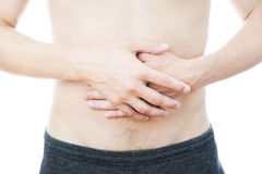 Abdominal pain in men stock images