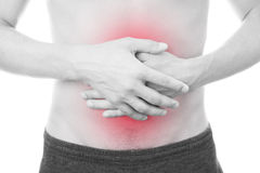Abdominal pain of the men. Isolated on white background.  Red dot. Black and white photography Stock Images
