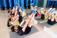 Abdominal plate training core group at gym Stock Photography