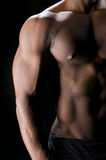 Abdominals and Biceps in Shadows stock images