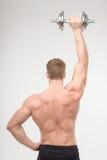 Abdominals con pesas de gimnasia Fotos de archivo libres de regalías