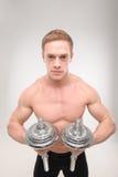 Abdominals con pesas de gimnasia Foto de archivo