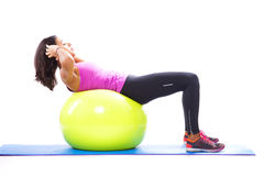Abdominals with a fitness ball. At studio Royalty Free Stock Image