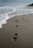 Abdrücke auf dem Strand Stockfotografie