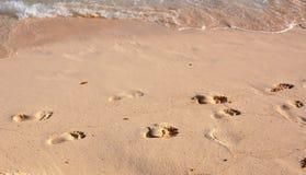 Abdrücke auf Sand. Stockfoto